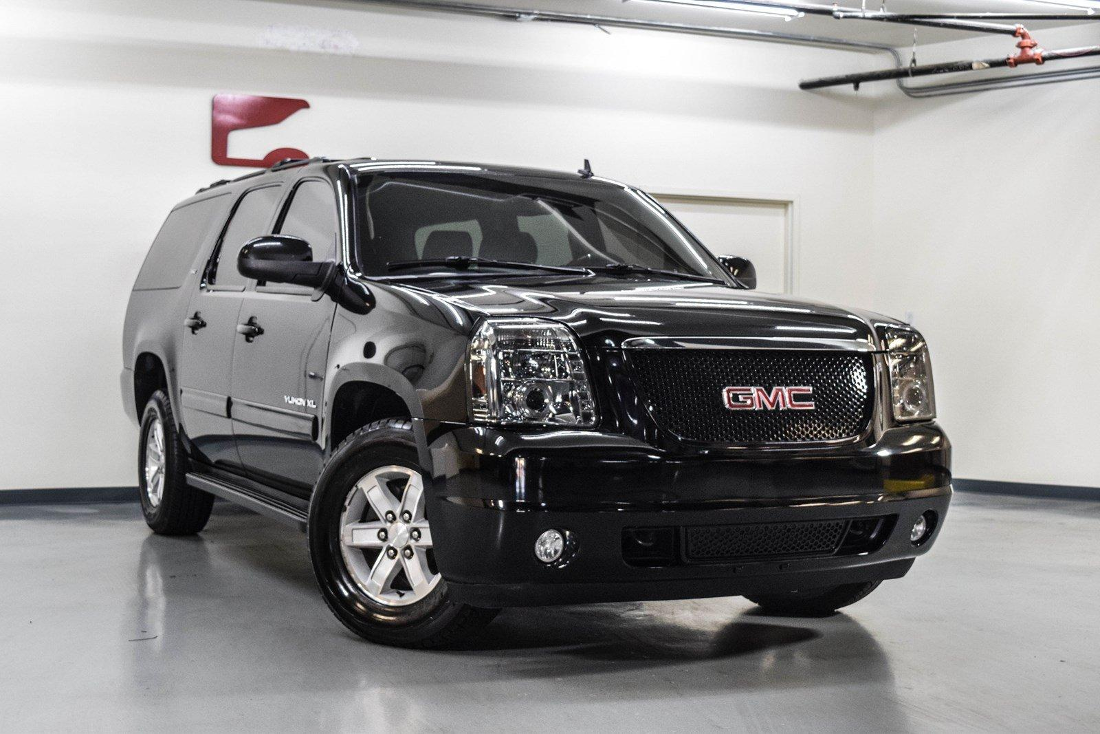 cargurus yukon general copyright gmc tahoe compare quarter pic view front xl motors chevrolet overview exterior manufacturer cars