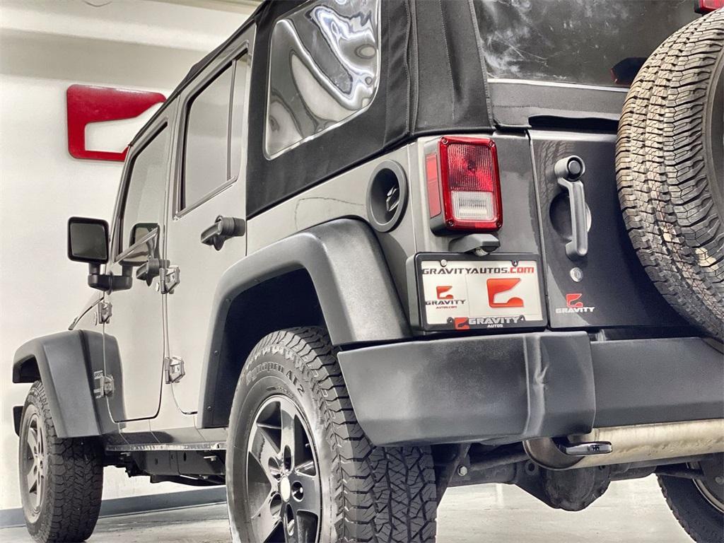 Used 2018 Jeep Wrangler JK Unlimited Sport for sale $34,476 at Gravity Autos Marietta in Marietta GA 30060 10