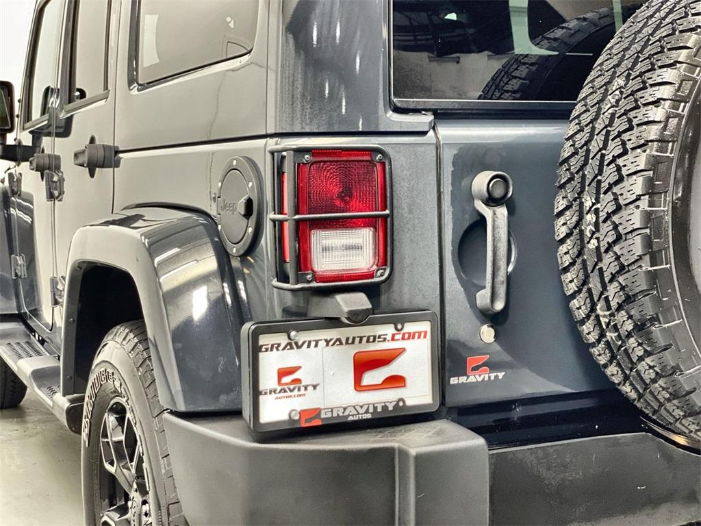Used 2018 Jeep Wrangler JK Unlimited Sahara for sale $38,444 at Gravity Autos Marietta in Marietta GA 30060 9